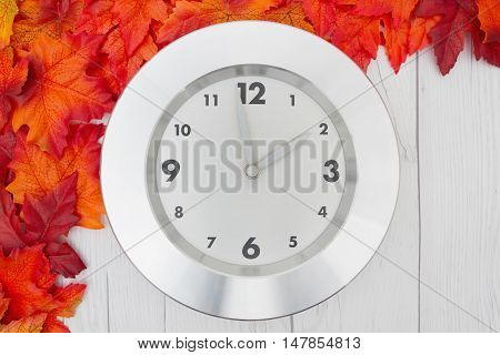 Fall Time Change Some fall leaves and a clock on weathered wood