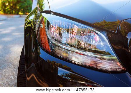 Close-up Of The Car Headlights Wheel