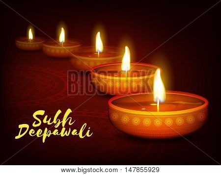 Elegant Greeting Card with illuminated Oil Lamps (Diya) and floral rangoli decoration, Traditional Indian Festival background for Subh Deepawali (Happy Deepawali or Diwali) celebration.