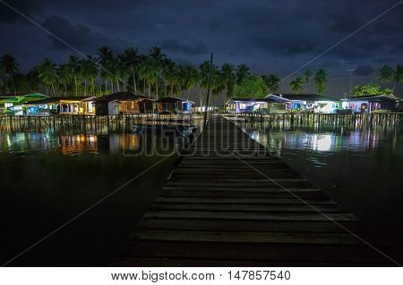 Night landscape with moody sky seconds before a storm at Omadal Island,Semporna,Sabah,Borneo.