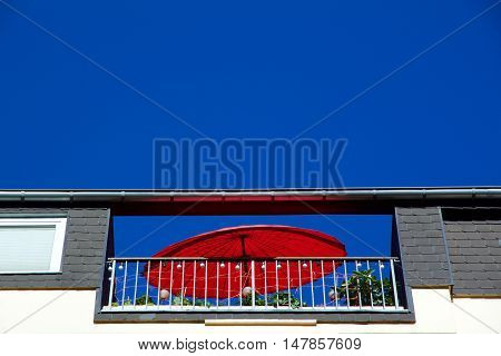 Red Sun Umbrella On A Rooftop Patio