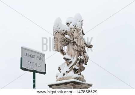 Angel Statue With Wings Back View Winter In Rome