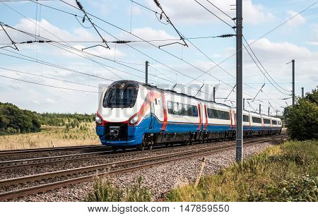 High speed train on the move through countryside