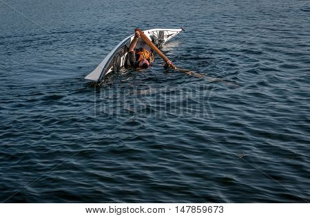 man rolling with a kayak on a lake - serial pictures 7 of 11