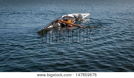 man rolling with a kayak on a lake - serial pictures 8 of 11