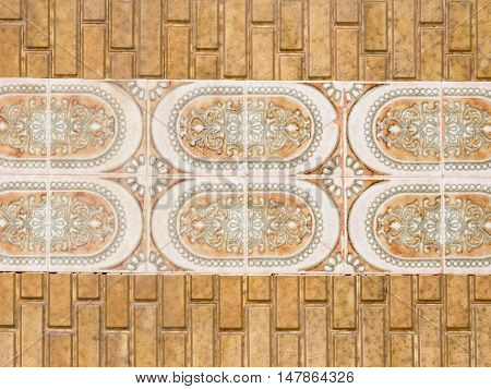 old ceramic terracotta paving tiles with stylized floral ornaments old seams
