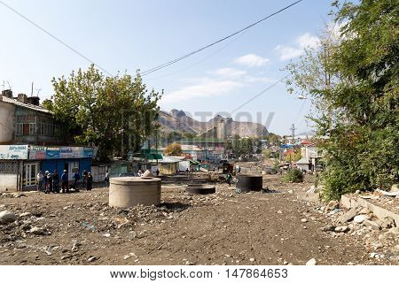 Osh, Kyrgyzstan - October 05, 2014: An unfinished road under contruction in the city center