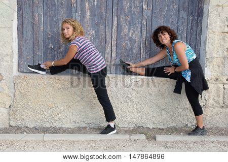 Two Happy Women Stetching Before A Jogging