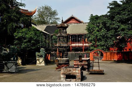 Dan Jing Shan China - November 16 2012: Courtyard with Fu Dog statues a pagoda style iron brazier and incense burners at the Fo Shan Gu Xi Buddhist Temple