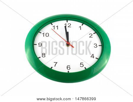 Big wall clock shows almost twelve o'clock isolated on white close up