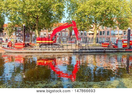 The Dutch city Delft with the channel in the green duckweed.