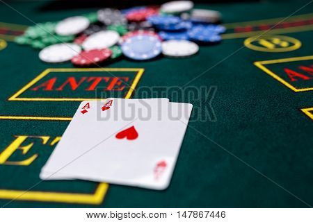 Poker chips on a poker table at the casino. Closeup. two aces, a winning combination. Chips winner