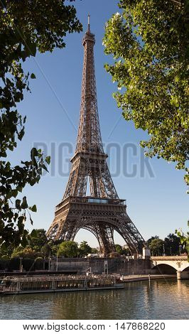 The Eiffel tower is a wrought iron lattice tower on the bank of Seine river in Paris France. It is named after the engineer Gustave Eiffel whose company designed and built the tower.