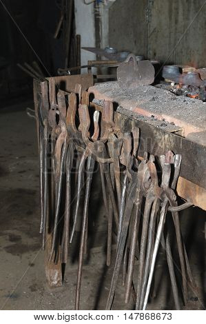 Old blacksmith tools in the manufactory .