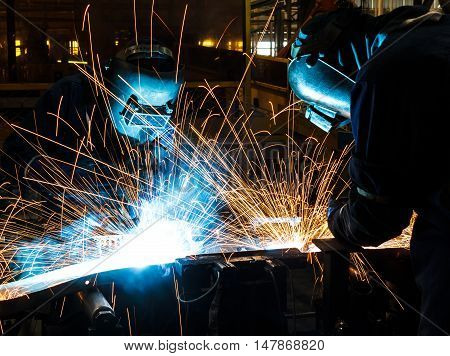 The term worker with protective mask welding metal.