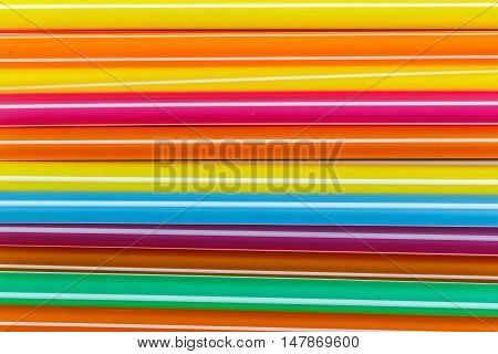 The Closeup Multi Color flexible straws and background