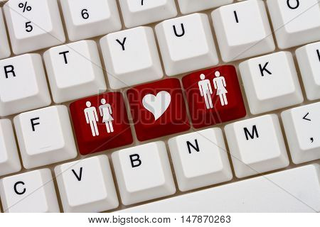 Swingers Internet Dating Sites A close-up of a keyboard with red highlighted symbol of man and women couples and heart