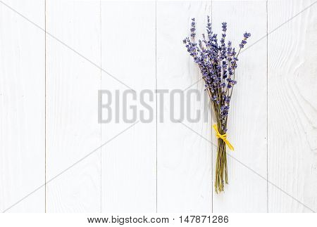 bouquet of dried lavender on white wooden table top view, mock-up