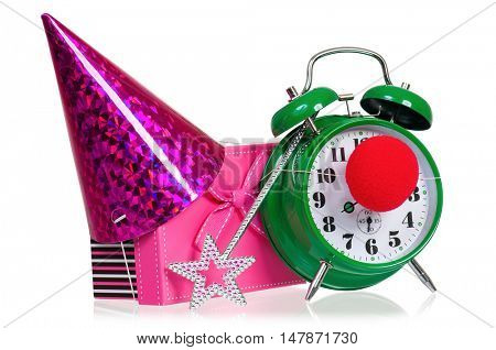 Alarm clock with clown nose. Birthday cap, gift box and magic wand. Time for the holiday's concept with clock and present, isolated on white background.