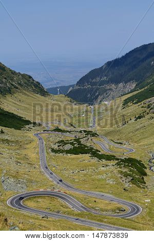 Transfagarasan - High altitude winding road in Carpathians mountains panorama.