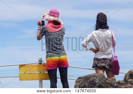 Semporna,Sabah-Sep 10,2016:Tourists enjoying amazing view from top of Bohey Dulang island Semporna,Sabah.The greatest tourist attraction of Semporna with bright blue water & rocky shore in the islands