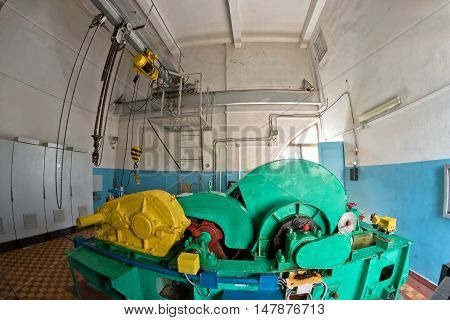 Technical room with a large electric pump for filling and draining the water from the camera locking