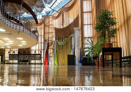 VELIKY NOVGOROD RUSSIA - SEPTEMBER 8 2016. Interior of building of Regional Drama Theater named after Fyodor Dostoevsky Veliky Novgorod Russia - illuminated architecture inside