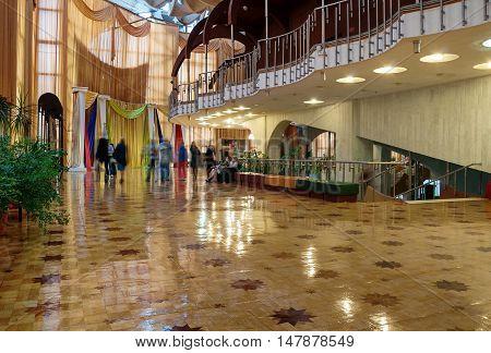 VELIKY NOVGOROD RUSSIA - SEPTEMBER 8 2016. Interior of Regional Drama Theater named after Fyodor Dostoevsky with visitors walking around Veliky Novgorod Russia