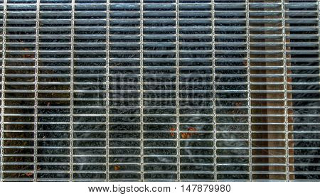 HDR image of a metal grate over water.