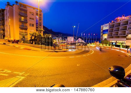 MONTE CARLO, MONACO - AUGUST 27, 2016: The Grand Hotel hairpin is very well known of the Formula 1. Fragment of the road along which the Formula 1 pass through in Monte Carlo at night, Monaco