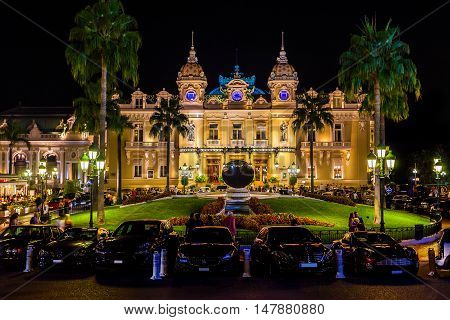 MONTE CARLO, MONACO - AUGUST 27, 2016: The grand Casino Monte - Carlo at night with illuminated facade. The Kingdom of Monaco on Azure coast.