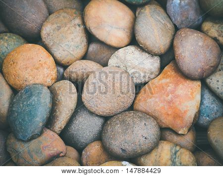 Colorful of round peeble stone texture and background