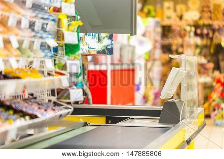 Closeup of a Checkout Counter in a Supermarket