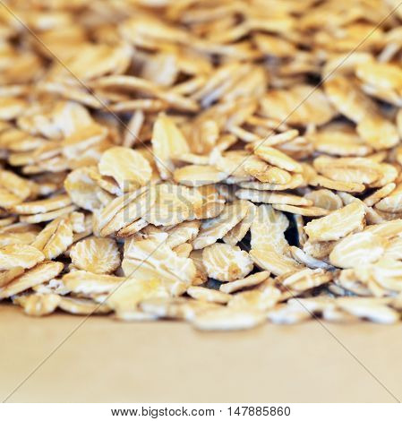 Pile of oat flakes in paper bag