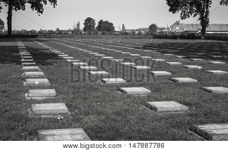 FLANDERS FIELDS, Belgium - MAY 12, 2016: Rows of flat stone grave markers in the cemeteries of western Belgium. This is just one of about 800 cemeteries in that mark the graves of military personnel who died in the first World War.