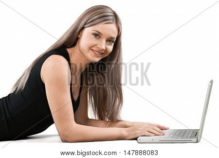 Smiling Woman Lying Down in Front of Her Laptop - Isolated