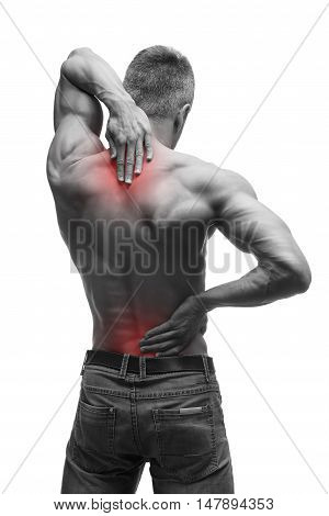 Middle aged man with back pain muscular male body studio isolated shot on white background with red dot black and white photography