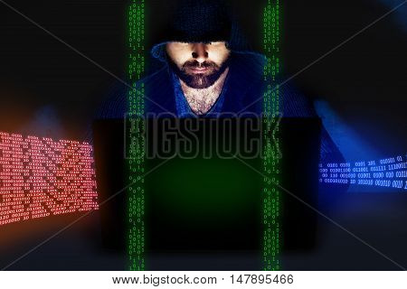 Man working at computer in dark empty room. Internet security concept