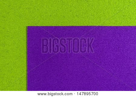 Eva foam ethylene vinyl acetate dark purple surface on apple green sponge plush background