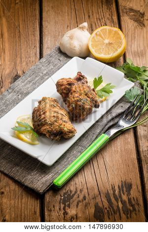 breaded chicken legs with parsley and lemon