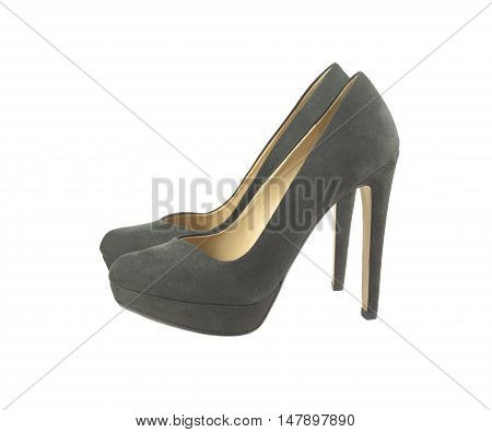 Two beautiful female suede shoes with high heel isolated on white side view closeup
