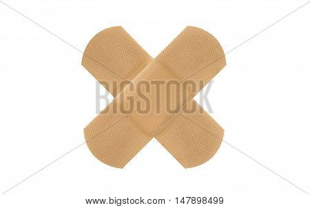 close up on X sign adhesive plaster isolated on white background