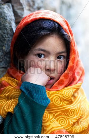 TURTUK, INDIA - JUNE 13, 2012: Shoolgirl from Baltistan poses for a photo during her break time in Turtuk Village, Ladakh, North India
