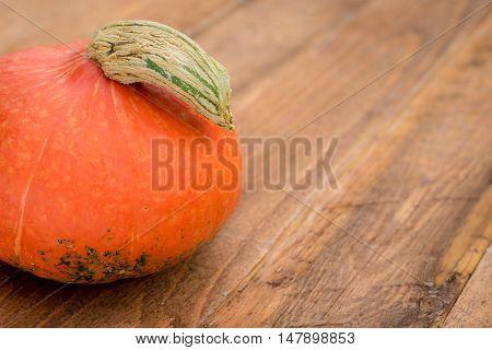 Detail of a Hokkaido Pumpkin on wooden background