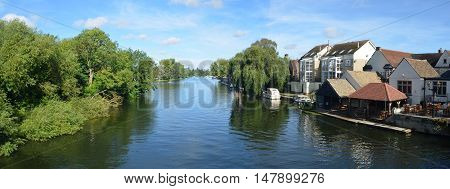 St Neots, Cambridgeshire, England - September 11, 2016: The river Ouse, Regatta meadows and riverside buildings at St Neots Cambridgeshire England.