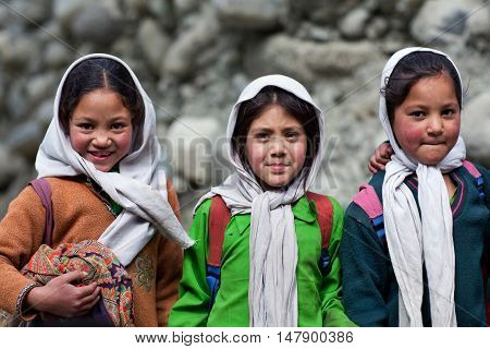 TURTUK, INDIA - JUNE 13: Balti students poses for a photo during their break time on June13, 2012 in Turtuk Village, Ladakh, India