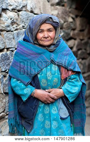 TURTUK, INDIA - JUNE 13, 2012: Woman from Baltistan poses for a photo in Turtuk village, Ladakh, Jammu and Kashmir State, North India