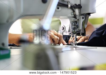 Production of clothes, sewing on a machine .