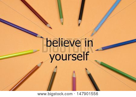 Colored Pencils written showing to center with a word belive in yourself