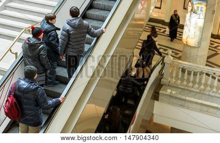 Escalators in Modern Shopping Mall with People